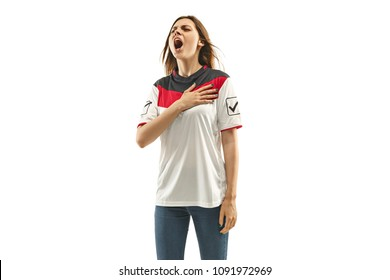 egyptian female fan celebrating on white background. The young woman in soccer football uniform as winner standing and singing a hymn isolated at white studio. Fan, support concept. Human emotions