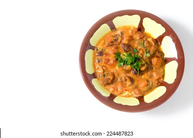 Egyptian foul medammes, a staple of the country's diet, made from fava (broad) beans, tomato, onion, garlic,
