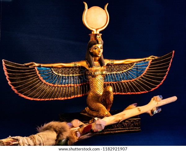 Beautiful Kneeling in black and gold the Egyptians goddess Isis