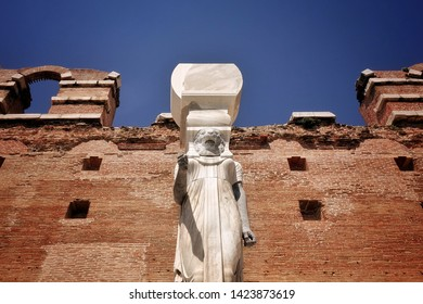 Egyptian Goddess Statue in Red Bazilica of Antique City Bergama in Turkey
