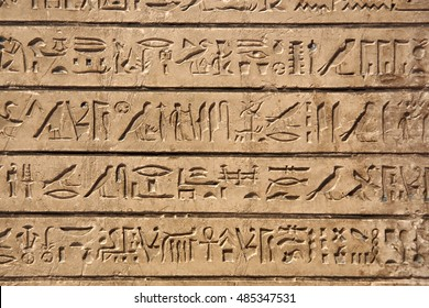 Egyptian hieroglyphs carved in sandstone
