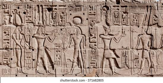 Egyptian hieroglyphs. Hieroglyphic carvings on a wall