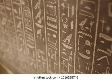 Egyptian hieroglyphs on the wall.