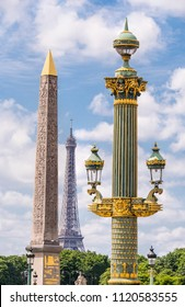 Egyptian Luxor Obelisk, Iconic Landmark Steel Structure Eiffel Tower, Ornate Lamp Post in Place de la Concorde and Sky and Clouds in Paris France.