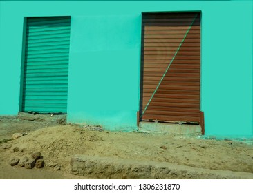 Egyptian muddy Street with Closed storage doors on a bright turquise background. Stock Image.