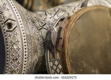 Egyptian musical instruments in detail. A darbuka and a riqq.