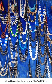 Egyptian necklaces on blue background