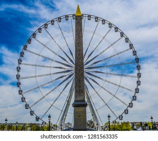Egyptian obelisk decorated with hieroglyphics and ferris wheel, Place de la Concorde, Paris