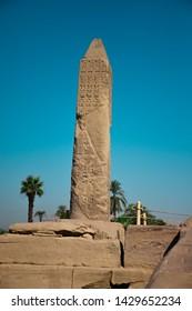 Egyptian Obelisk Pharaonic in the Karnak Temple in the middle of Ruins of the Pharaohs Era, Luxor, Egypt