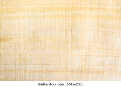 Egyptian papyrus paper texture background. Papyrus is used in ancient times as writing surface, made from the pith of papyrus plant named Cyperus papyrus, widely used across the Mediterranean region.