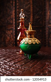 Egyptian perfume bottles in warm romantic setting.