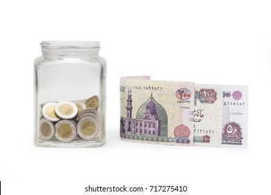 Egyptian Pounds and Coins in Jar, Egyptian Banknotes , Isolated