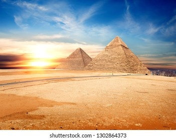 Egyptian pyramids in the Giza desert at sunset