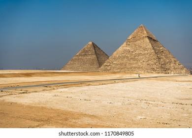 Egyptian pyramids on sky background