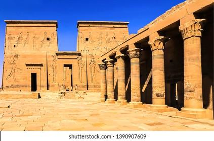 Egyptian temple columns and frescoes. Egyptian pyramids temple. Egyptian temple columns. Egyptian tourism scene