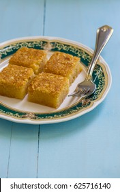 Egyptian traditional sweet Basbousa - a cake made with semolina, butter and sugar syrup.