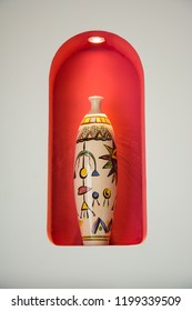 Egyptian vase with colorful pattern on red background