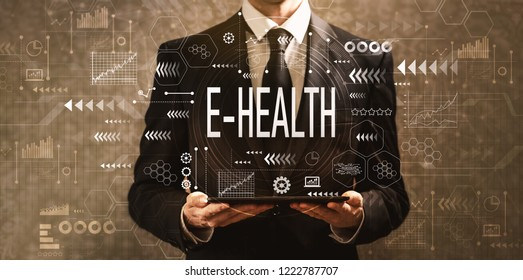 E-Health with businessman holding a tablet computer on a dark vintage background