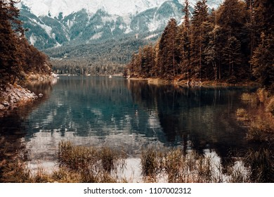 The Eibsee at the foot of the mountain Zugspitze