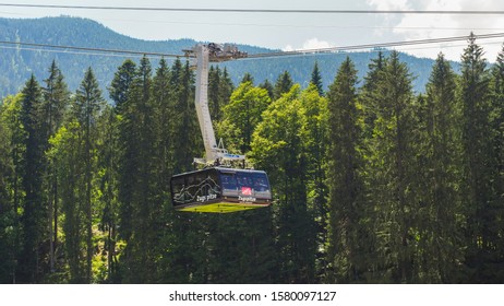 Eibsee / Germany -06 20 2018: Tramway cabin or cable car with people in the background of spruce trees. The Seilbahn Zugspitze is an aerial tramway running from the Eibsee Lake to the top of Zugspitze
