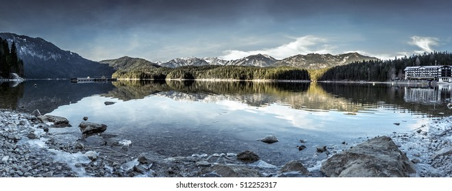 Eibsee lake winter panorama - Panorama image with the lake Eibsee and its icy shore, near the municipality Grainau, in the district of Garmisch-Partenkirchen, in Bavaria, Germany