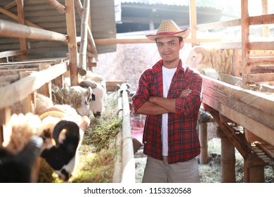 eid al adha greeting for qurban day. farmer asian man standing with cross arm on farm. yogyakarta indonesia. august 10, 2018.