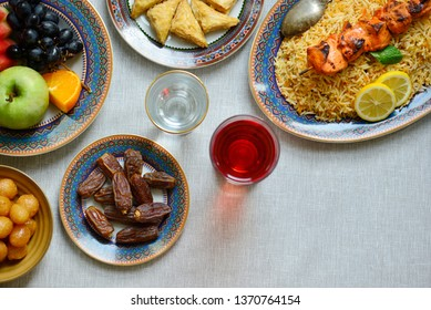 Eid al fitr - Festival of breaking the fast.  Biryani, dates fruits and Sherbet spread shot from above. Breaking fast in the evening during holy month of Ramadan with nutritious food.