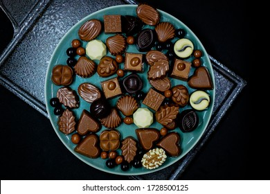 Eid celebration food and festive background. View from top. traditional celebration chocolate for eid. chocolates on black granite plate.