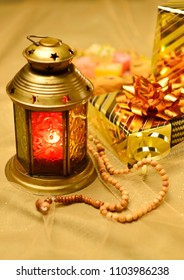 Eid gift presentation. ramadan lantern and gift boxes. Islamic festive object and background.