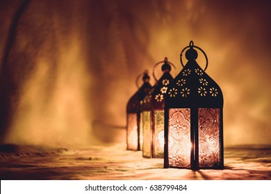 Eid lamps or lanterns for Ramadan and other islamic muslim holidays, with copy space for text. Artistic monotone edit.