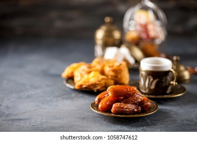 Eid mubarak with arabic coffee pot and dates. Dried dates and coffee on a dark background. Ramadan, Eid concept