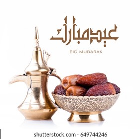 Eid mubarak with arabic coffee pot and dates