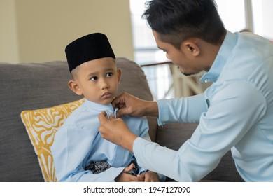 Eid Mubarak celebration concept, father and son moment preparing to celebrate Eid