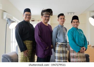 Eid Mubarak celebration concept, group photo of Malaysian wearing traditional clothes