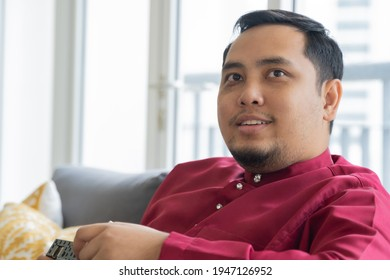 Eid Mubarak celebration concept, middle age Malay guy wearing traditional clothes