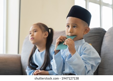 Eid Mubarak celebration concept, two siblings wearing traditional clothes