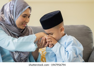 Eid Mubarak celebration moment, mother and son kiss and shaking hands symbol of forgiving