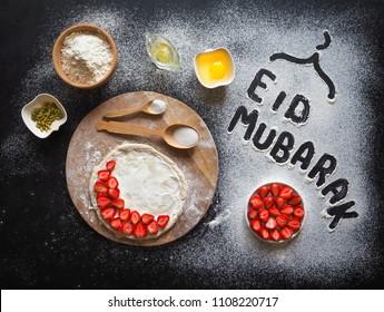"Eid Mubarak - Islamic holiday welcome phrase "" happy holiday"", greeting reserved. Arabic cuisine background"