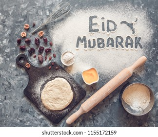 """Eid Mubarak - Islamic holiday welcome phrase """" happy holiday"""", greeting reserved. Arabic cuisine background. Tinted"""