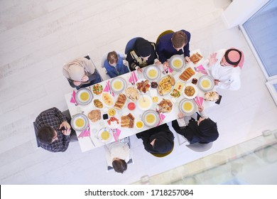 Eid Mubarak Muslim family having Iftar dinner  Eating traditional food during Ramadan feasting month at home. The Islamic Halal Eating and Drinking Islamic family top view
