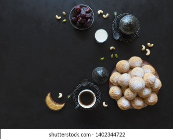 "Eid and Ramadan Dates Sweets - Arabian cuisine background. Egyptian cookies ""Kahk El Eid"". Top view."