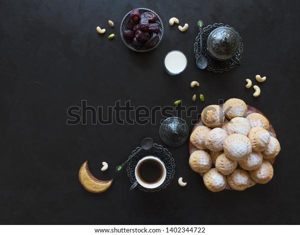 "Eid and Ramadan Dates Sweets - Arabian cuisine background. Egyptian cookies ""Kahk El Eid"". Top view."