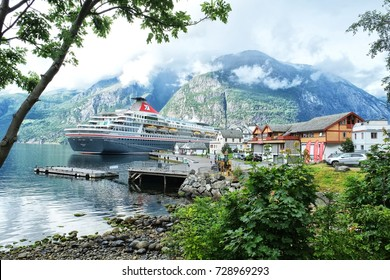 Eidfjord, Norway - 08.04.2017: A cruise ship moored in lovely Eidfjord a foggy day