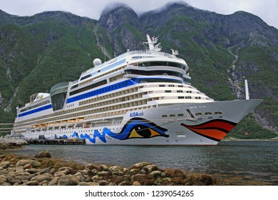 EIDFJORD, NORWAY - August 19, 2013: Cruise ship AIDA sol in port of Eidfjord with nice view on the mountains in the Fjord with cloudy horizon