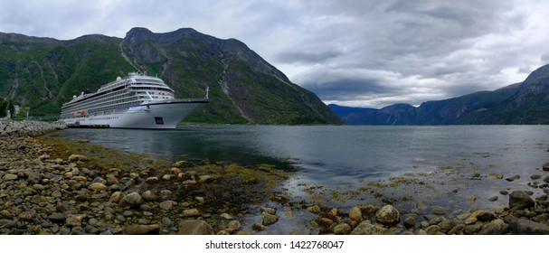 EIDFJORD, NORWAY - August 2018: Cruise ship sol in port of Eidfjord with nice view on the mountains in the Fjord with cloudy horizon
