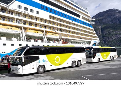 EIDFJORD, NORWAY - June 11, 2017: coaches of tide ASA waiting at AIDAsol for shore excursion passengers. Tide is one of the largest coach companies in Norway.