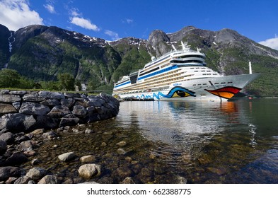 EIDFJORD, NORWAY - June 11, 2017: AIDAsol  at Eidfjord Cruise Terminal. AIDAsol is a Sphinx class cruise ship, built at Meyer Werft for AIDA Cruises, one of ten brands owned by Carnival Corp.