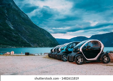 Eidfjord, Norway  - June 13, 2019: Many Black And Blue Colors Renault Z.E. Cars Parked In row. The Renault Z.E. or Zero Emission is a line of all-electric cars from Renault.