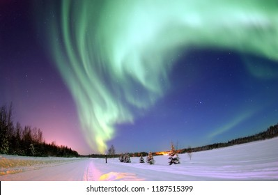 EIELSON AIR FORCE BASE, Alaska -- The Aurora Borealis, or Northern Lights, shines above Bear Lake here Jan. 18. The lights are the result of solar particles colliding with gases in Earth's