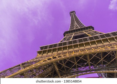 Eifel Tower full length bottom up low angle shot from tower basement with violet sky background